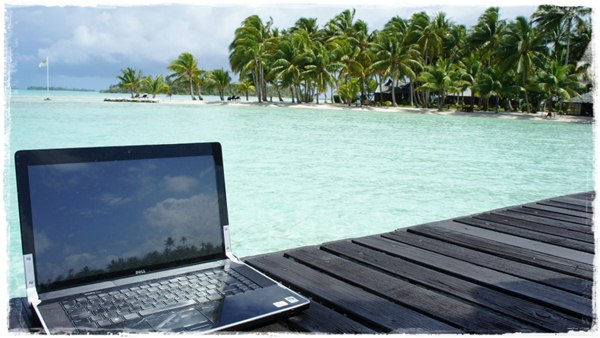 Not that you'd actually wanna work on the beach (too much sand and poor screen visibility)... but you get the idea.